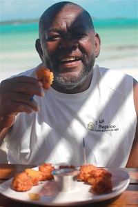 "Opposite page: Berlie ""Bugaloo"" Williams initiated fresh-from-the-sea conch salad over twenty years ago. These days, folks flock to Bugaloo's Conch Crawl in Five Cays for conch salad and his famous conch fritters."