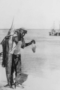 At seventy-six years old, Oscar Talbot Sr. is a living legacy of his family's long history of seafaring. This photo was taken at Salt Cay's port of entry, Dean's Dock, at the Salt Shed around 1963.