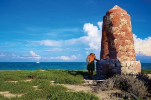 A stone tower stands sentinel on Hogsty Reef.