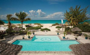 The Meridian Club's pool/patio is steps from the beach.