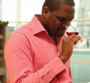 "Shane Jones is shown ""nosing"" a glass of wine."