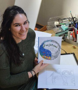 Alizee Zimmermann with her new coloring book, Reefscapes.