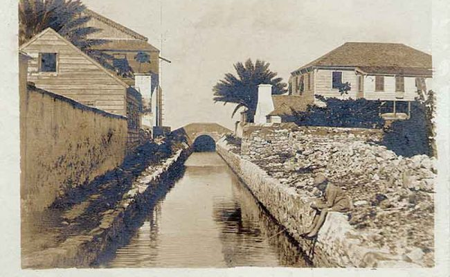 An Edmund Neale Coverley real photo postcard of a canal leading from the sea to salt ponds on Grand Turk in 1905.